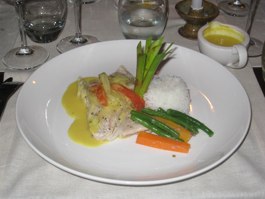 Nile Perch topped with tomato, onion, & fresh herbs, served with fragrant rice, seasonal vegetables, and Beurre Blanc sauce