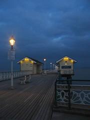 Lights on the Pier (Dave Roberts3) Tags: blue sky lamp wales night clouds bench geotagged lights evening coast pier path cymru perspective victorian glamorgan udo lamps railings legacy penarth caminho valeofglamorgan tup blueribbonwinner theunforg