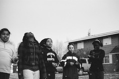 outdoor math lesson interrupted by hail (lauritadianita) Tags: blackandwhite bw black alaska kids children spring professional africanamerican nikonf3 mixedrace blackgirls tmax100film
