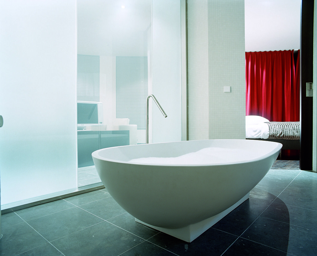 Modern egged shaped bathtub reflecting modernity and simplicity in the interior design of a Concorde Suite at the Hotel Concorde Berlin in Germany