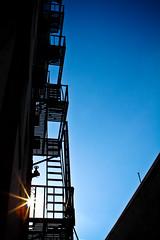 112/365 Vault Club Escape (Paul K.-QuixoteImages) Tags: stairs bluesky fireescape pomona sunflare inlandempire paulknight artscolony thevaultclub fadedblurred3652010 quixoteimagescom