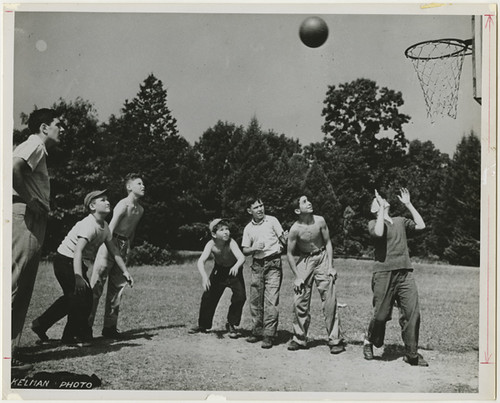 Boys playing basketball outside