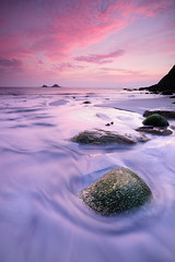 Round the rock (le-spikey) Tags: pink sunset red beach water yellow rock landscape moving nikon soft cornwall hard sigma national porth lee trust 1020mm grad afterglow nanven 06nd d300s coastuk