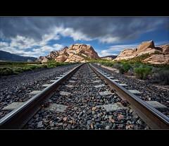 Mormon Rocks and Tracks II (TomGrubbe) Tags: longexposure railroad landscape rocks tracks railroadtracks mormonrocks cajonpass ndx400 hoyandx400
