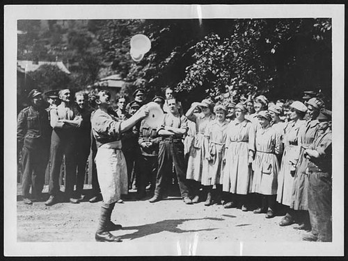 W.A.A.C. cooks in France watching a British soldier doing a juggling turn with plates