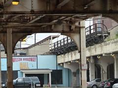 Abandoned platform and storefronts (nangeloni47) Tags: chicago abandoned rain train cta publictransit publictransportation platform rail theel el uptown transit wilson l disused elevated redline purpleline thel chicagotransitauthority rapidtransit heavyrail purplelineexpress transitchicago wilsonbroadwaymall