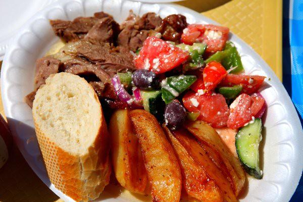 roast lamb, roast potatoes, and greek salad