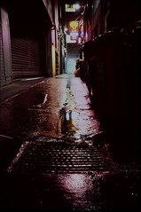 peep show nights #2 (mugley) Tags: city pink 2 urban film wet water rain sign yellow night reflections dark grate garbage alley neon fuji minolta garage sexshop australia melbourne slide victoria scan drain chrome lane transparency wheeliebins epson pointandshoot cbd konica positive waste refuse peeps e6 bins urbanlandscape sensia rubbishbins sensia100 v700 rollerdoor clubx fujisensiaii100ra staralley trashclams freedomzoom160 rivazoom160 minoltafreedomzoom160 innercitywasteservices