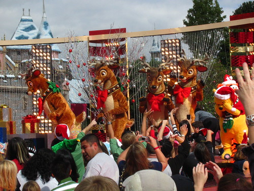 Disney Characters come out to dance with Nick Cannon in front of Sleeping Beauty Castle
