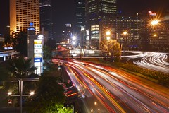 Jakarta traffic by night (Indo Pilot) Tags: city red cars fountain buildings indonesia stars lights town moving movement traffic vehicles busy jakarta flowing 365 3652010