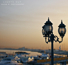 Lights Out (Rayan M.) Tags: morning light beach marina docks sunrise 50mm coast early dof pole jeddah shipyard saudiarabia lightsout            rayanmphotography