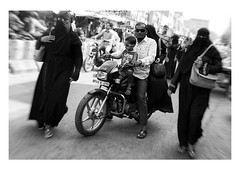 one man and his wives (handheld-films) Tags: india men women roleofwomen wife wives islam muslim niqab burka burqa family values city streets cities hyderabad blackandwhite monochrome motorbike male indian subcontinent group zoomfocus religion religious belief anonymity