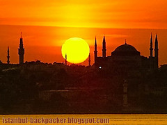 Sunset over Hagia Sophia, Istanbul (voyageAnatolia.blogspot.com) Tags: santa travel sunset sky orange sun holiday church monochrome silhouette yellow turkey photography photo holidays europe basilica monochromatic istanbul mosque turquie trkei dome silkroad sophia istambul turquia bosphorus contrejour minarets sultanahmet estambul hagia turqua tyrkiet turchia ayasofya bosporus   isztambul istanboel  turska    stambula   stambulas    istanbulo  voyageanatolia