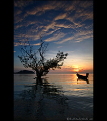 Railay East Sunrise (tsechel) Tags: reflection tree water silhouette clouds sunrise thailand boat east longtail krabi andamansea railaybeach canon50d leefilters