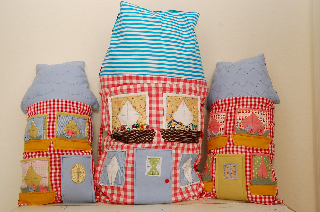 the three new dollhouse pillows