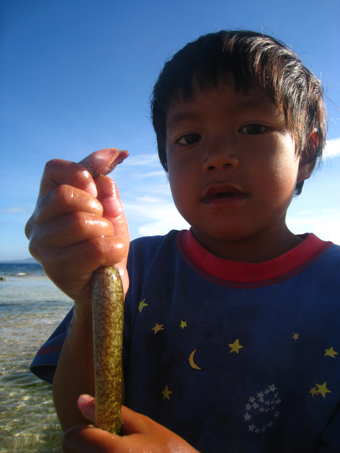 Local Boy Plays with Tiny Eels