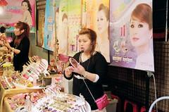 Advertising and reality (deepstoat) Tags: street zeiss 35mm taiwan contaxg2 kodakportra deepstoat