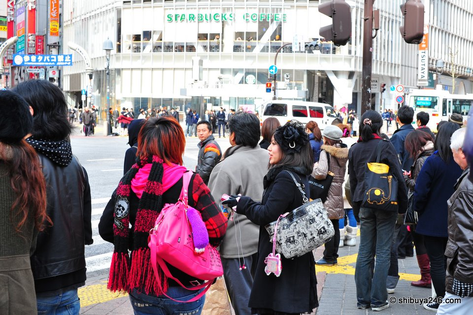Shibuya street fashion on show as people wait to cross at the lights.
