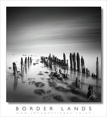 Border Lands (John Pettinger) Tags: blue sea white black west canon john mono long exposure angle wide somerset anchor mk2 5d lands scape boarder groynes groins canon1740 pettinger wwwjohnpettingercouk
