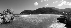 Labadoozie's are good (Noah Bolanowski) Tags: trees sky panorama white black mountains beach water haiti sand rocks waves hut foam mts labadee haitian clifs labadoozie