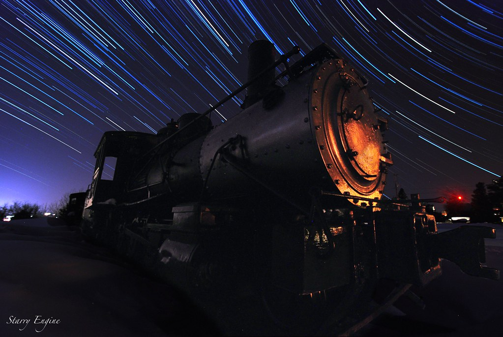 An old steam engine with star trails.