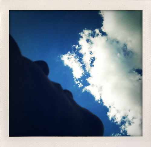 photo of person watching clouds