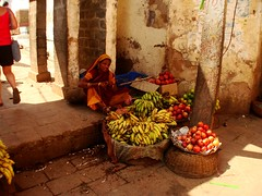 Selling fruits and veggies in Orchha, India (picsie14) Tags: red people orange india yellow portraits interestingness interesting warm colours interestingness2 orchha sadhus