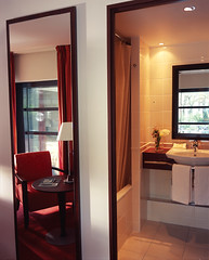Bathroom and modern room with red curtains at the hotel concorde montparnasse paris france (Concorde Hotels Resorts) Tags: paris france modern europe harmony simple montparnasse hotelroom stylish hotelbathroom interiordeisgn concordemontparnasse concordmontparnasse