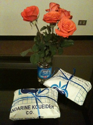 Bakery sweets (bought by us) and roses (from housekeeping)