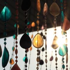*** (nomadic tendencies) Tags: light sunlight color beads flare sunburst flarefridays