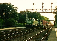 Eastbound Burlington Northern freight train approaching Highlands station. Hindsdale Illinois. September 1993.