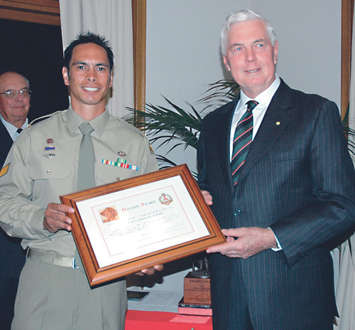 Governor-General Maj-Gen Michael Jeffery presents Cpl Albert 'Ta
