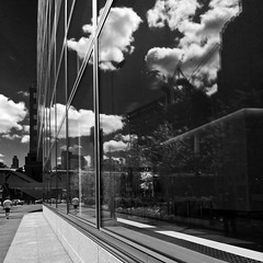 200 West Street, Reflections of Ground Zero (Jay Fine) Tags: nyc newyorkcity blackandwhite clouds manhattan batteryparkcity lowermanhattan goldmansachs 200weststreet