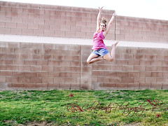 221/365 Jump (OceanBaby-in-SLC) Tags: pink blue portrait woman brick me grass wall shirt self project myself outside dance jump jumping mine days shorts 365 365days i whowantstohaveadrinkwithlittleoldmeisurecoulduseone