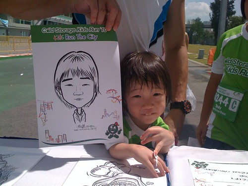 caricature live sketching for Cold Storage Kids Run 2010 - 26