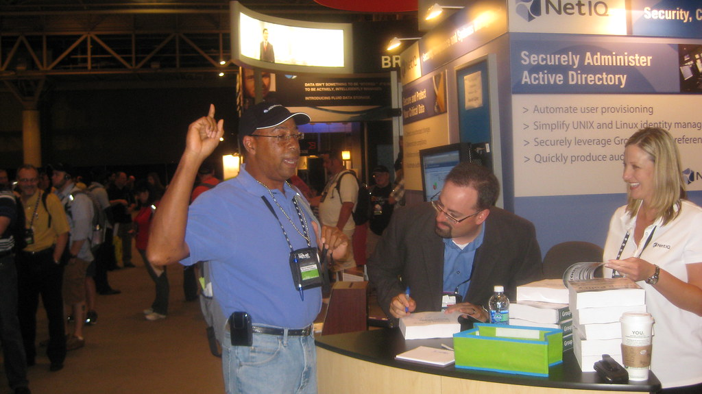 Jeremy signing his Group Policy book for Derrick Robinson