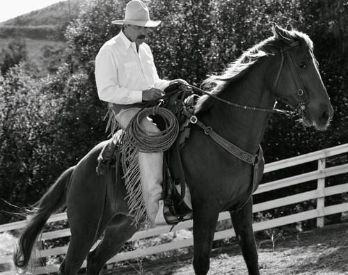 tom selleck riding a horse