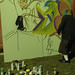Student artist painting during Art Capstone Project event