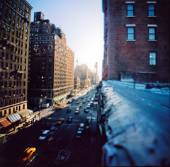 away we go (scott w. h. young) Tags: street new york city nyc newyorkcity blue windows roof light red sky urban orange brown sun west building 120 film up amsterdam buildings mediumformat high downtown looking kodak manhattan cab side horizon down uptown upper diana ledge intersection elevation avenue distance 80th atomic 38mm 400nc citrocity tagcrazymuchp athousandmovesaminute