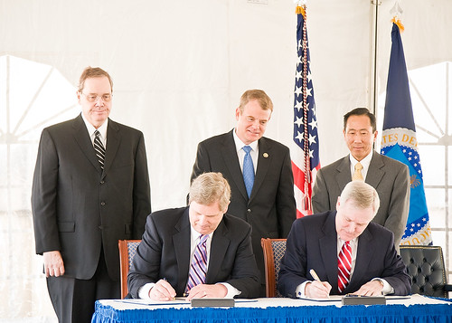 Seated, (L-R) Secretary Tom Vilsack and Secretary Ray Mabus sign the MOU between the Department of Agriculture and the Navy Looking on are Agriculture Under Secretary for Rural Development Dallas Tonsager, Congressman Mike McIntire and Roger Natsuhara, Assistant Secretary of the Navy, Installations and Environment (Acting).