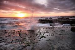 Turimetta Beach sunrise II (Adriana Glackin) Tags: longexposure morning summer sky seascape beach water clouds sunrise canon gold rocks surf adriana australia photograph nsw pinks 50d turimettabeach ndx400