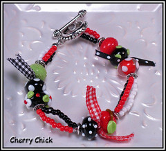 Mary's Ribbons Bracelet (Cherry Chick Jewelry) Tags: cherry cherries jewelry bracelet handcrafted lampwork beaded artisan artisanjewelry lampworkbeads cherryearrings beadedbracelet lampworkjewelry lampworkbracelet cherrychick cherrylampwork cherrychickjewelry