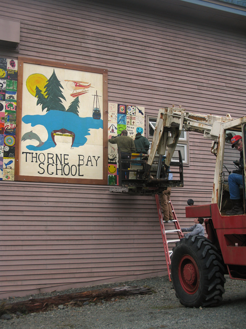installing new signage at Thorne Bay School, Thorne Bay, Alaska