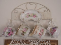 Close-up of creamer display (eg2006) Tags: china old pink roses floral vintage pretty purple antique picture lavender german romantic dishes decor luster 2010 lusterware creamers shabbychic