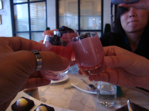 Clinking our panna cotta shots