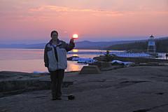 Tammy holding up the sun (KarenR-TB) Tags: sunset lighthouse minnesota lakesuperior grandmarais