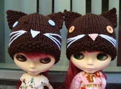 The twins in matching kitty hats