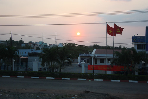 Vietnam flags and a sunset