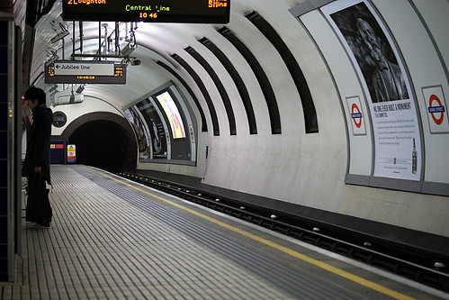 Lone traveller on a deserted london tube
