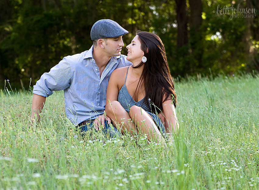 photo of tallahassee couple in field of green grass